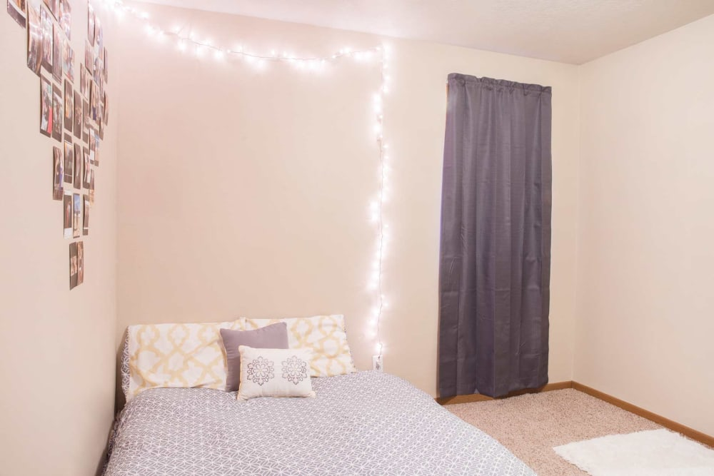 A cozy, decorated bedroom at Stone Court in Ames, Iowa