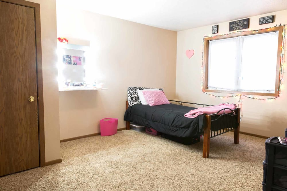 Apartment bedroom with furniture at Stone Court in Ames, Iowa