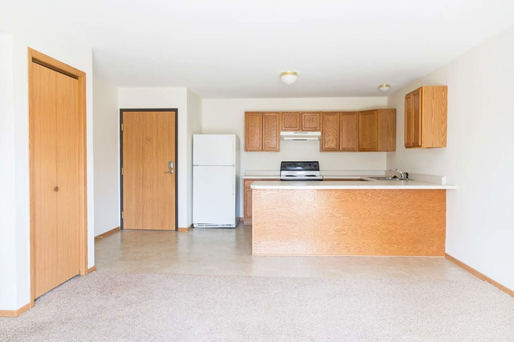 Entrance to a three bedroom apartment leads to the kitchen at Walnut Place in Ames, Iowa