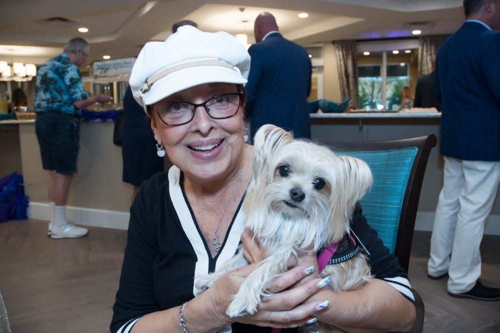 Resident and her dog at Symphony at Delray Beach in Delray Beach, Florida.