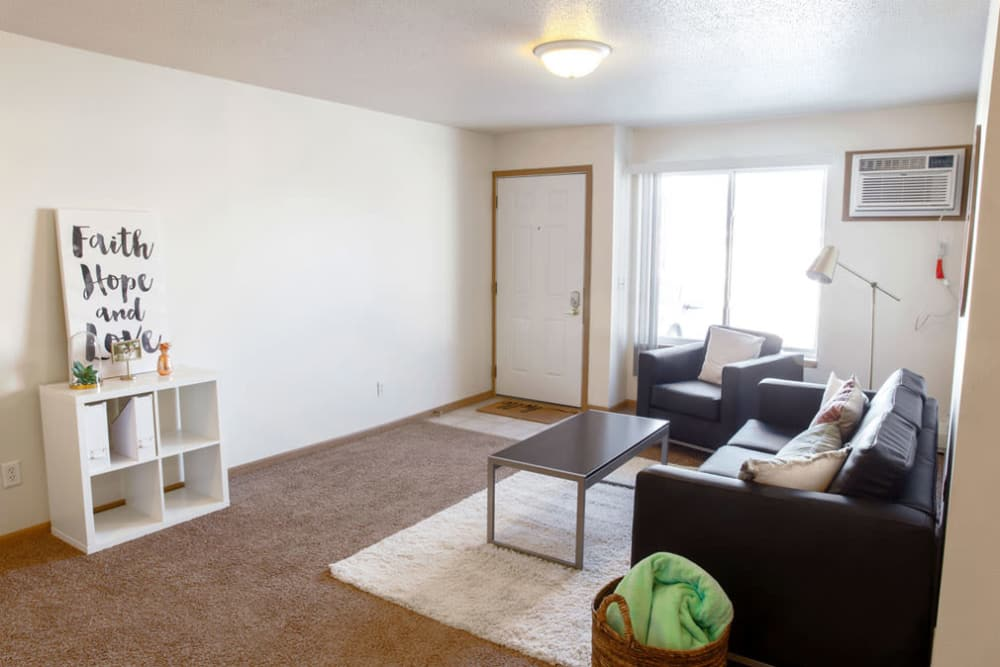 Apartment entryway leads to the living room at Campus View & Kirkwood Court in Cedar Rapids, Iowa