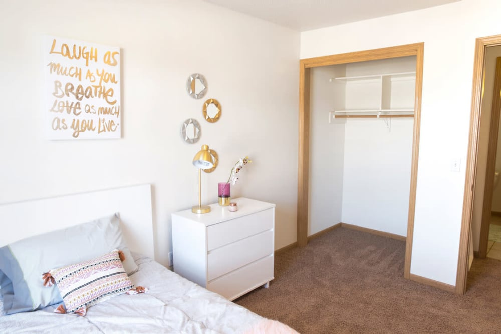 Single bedroom with an open closet at Campus View & Kirkwood Court in Cedar Rapids, Iowa