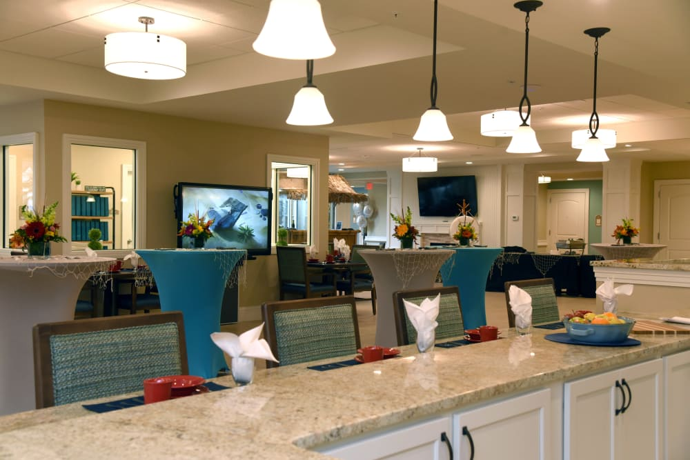 Dining area with counter seating at Symphony at Cherry Hill in Cherry Hill, New Jersey.
