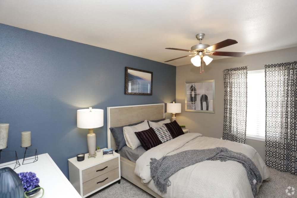Naturally well-lit bedroom at EnVue Apartments in Bryan, Texas