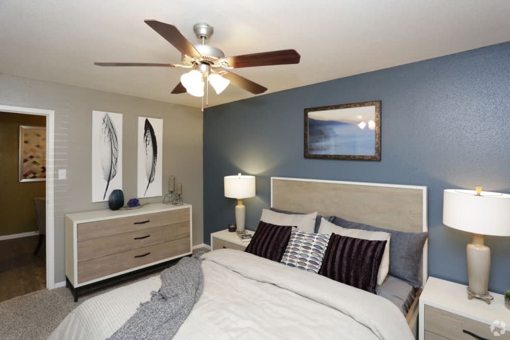 Enjoy a modern bedroom with ceiling fan at EnVue Apartments in Bryan, Texas