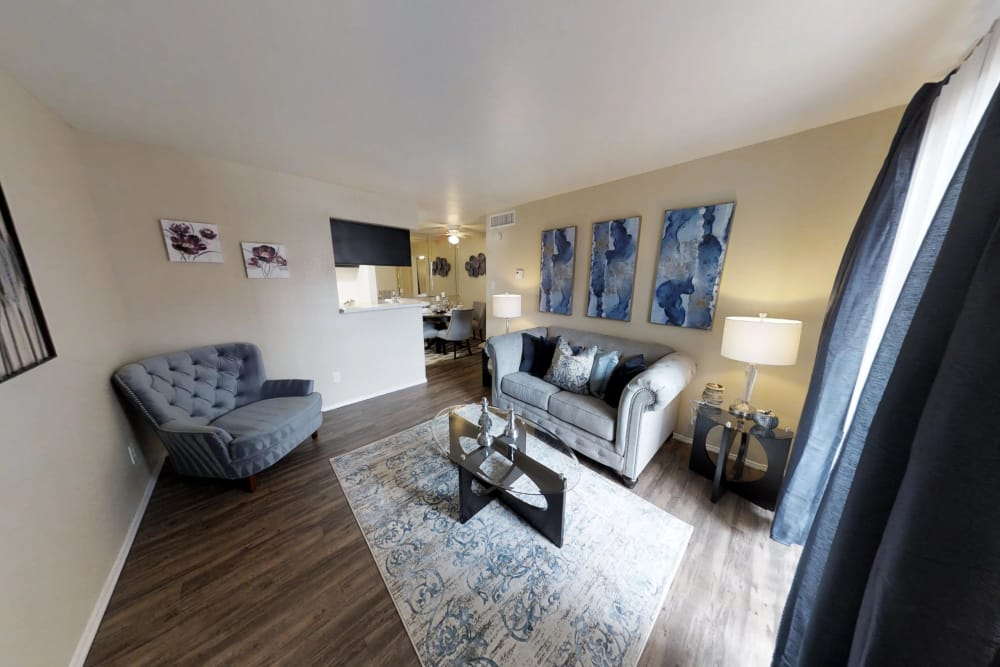 Spacious living area at Brookmore Hollow Apartments in Rosenberg, Texas
