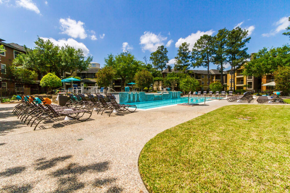 Sundeck around the pool on a beautiful day at Legacy at Cypress in Cypress, Texas