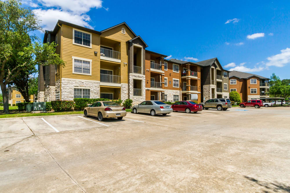 Exterior view of the apartments and parking area at Legacy at Cypress in Cypress, Texas