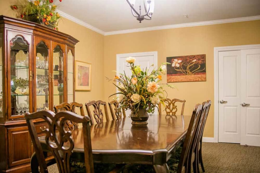 Dining table with flowers at Grace Manor Assisted Living in Nashville, Tennessee
