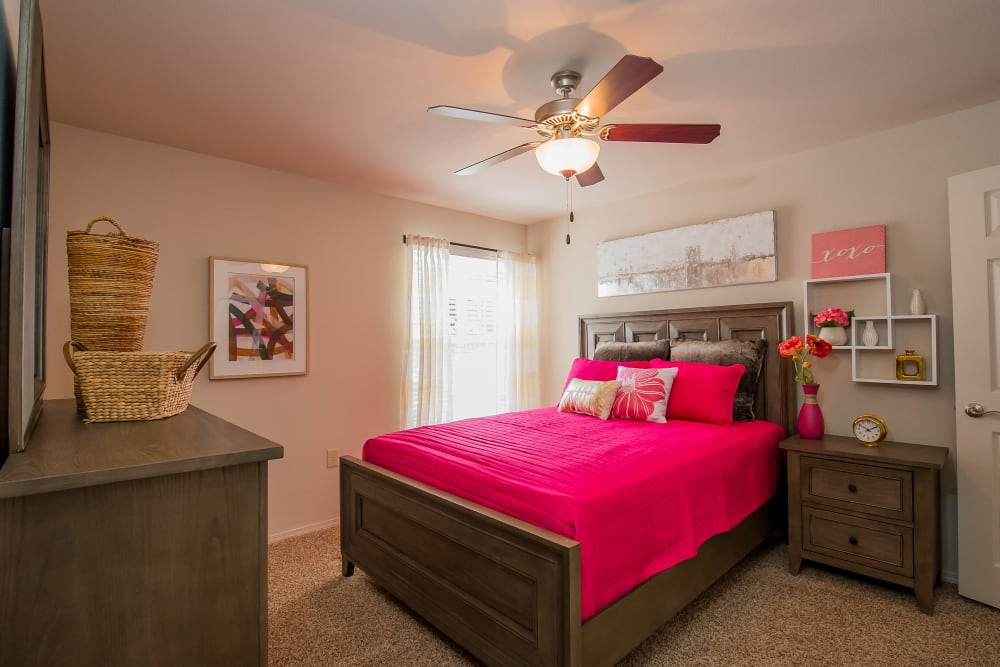 Bedroom with a ceiling fan at Fountain Lake in Edmond, Oklahoma