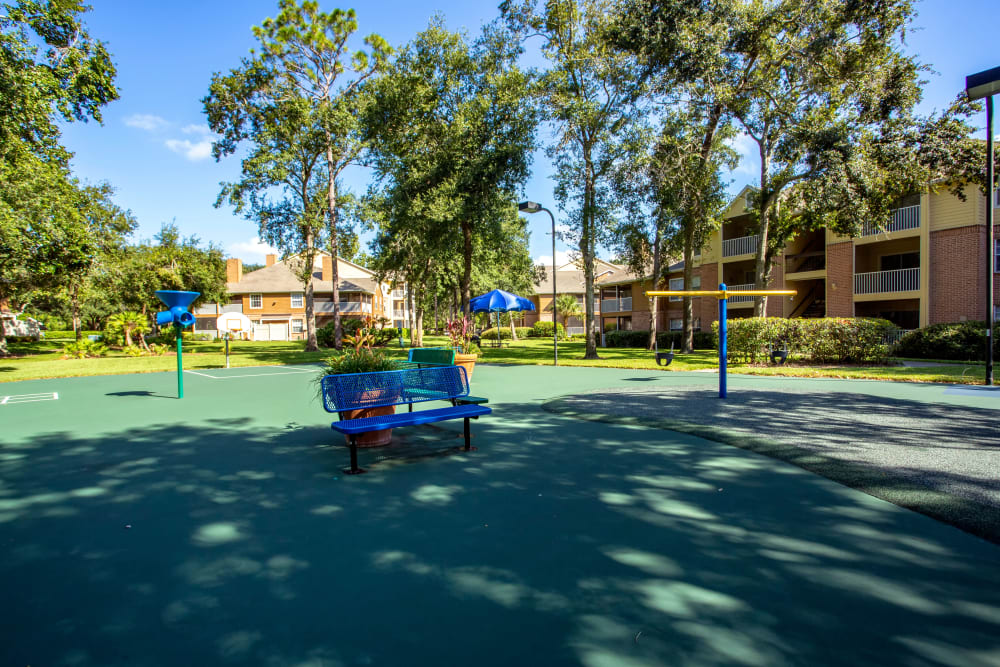 Swings and benches at IMT Newport Colony in Casselberry, Florida