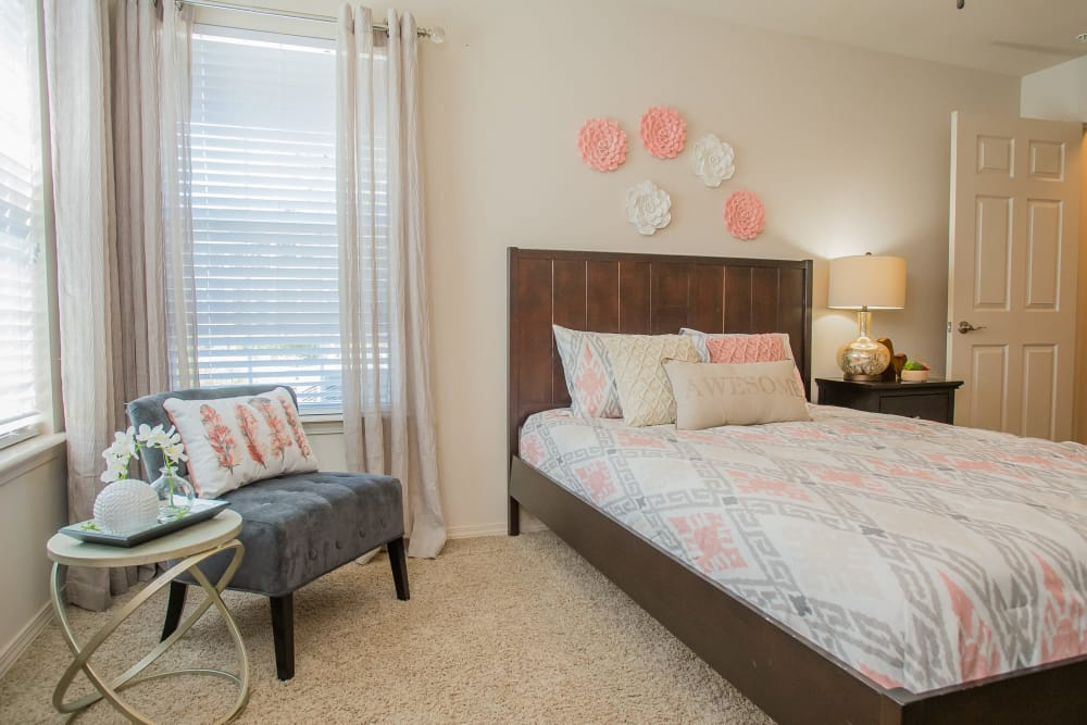 Bedroom with natural light at Nickel Creek Apartments in Tulsa, Oklahoma