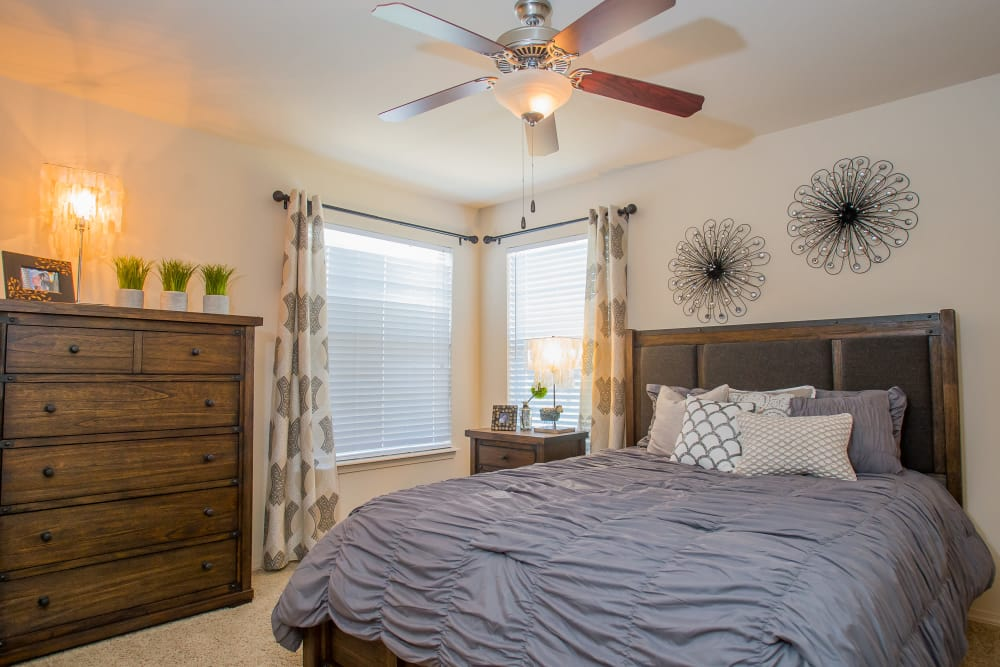 Cozy bedroom at Nickel Creek Apartments in Tulsa, Oklahoma