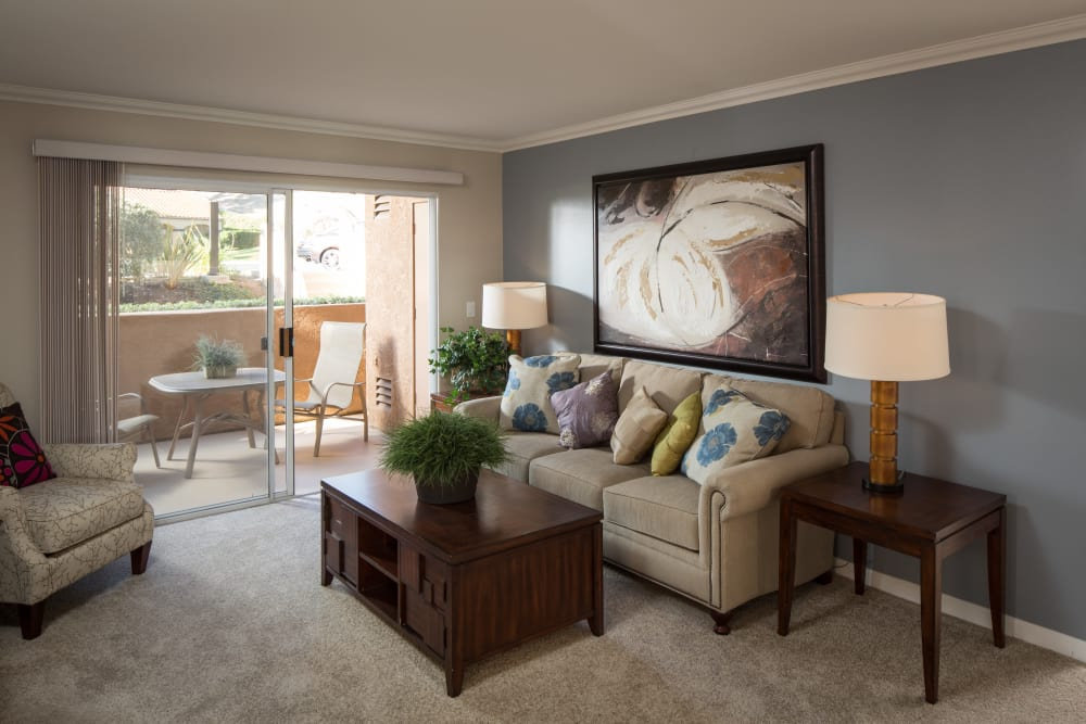 Lovely naturally lit model living room at Shadow Ridge Apartment Homes in Simi Valley, California
