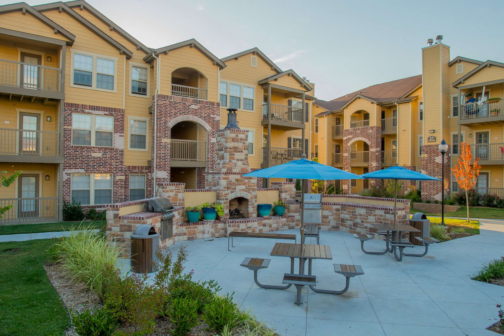 Outdoor patio with grills at Portofino Apartments in Wichita, Kansas