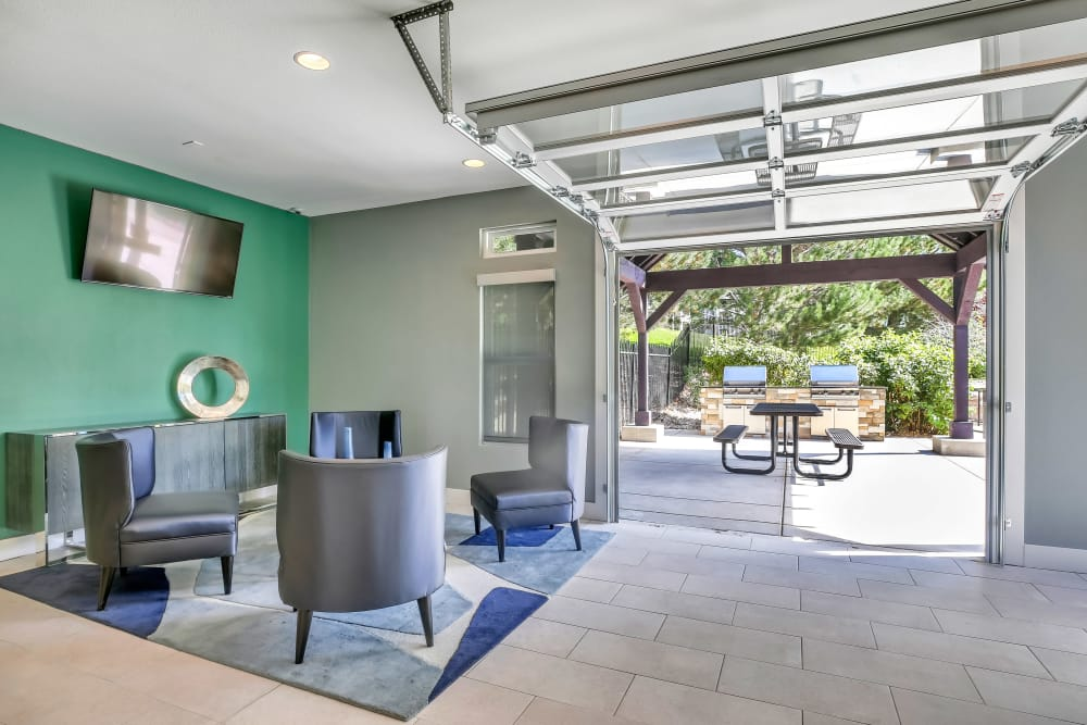 Indoor / Outdoor Lounge & BBQ Area at The Pines at Castle Rock Apartments in Castle Rock, Colorado
