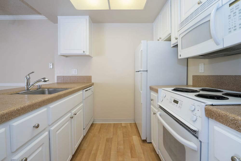 Lovely kitchen with white appliances at Valley Ridge Apartment Homes in Martinez, California