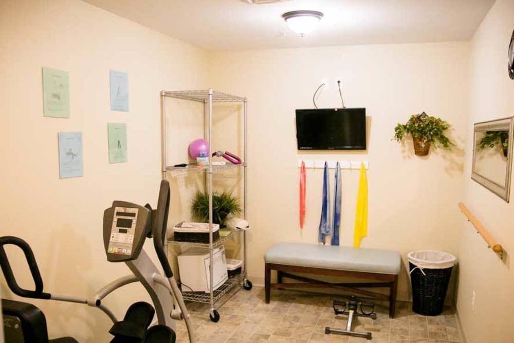 Fitness center with TV at Grace Manor Assisted Living in Nashville, Tennessee