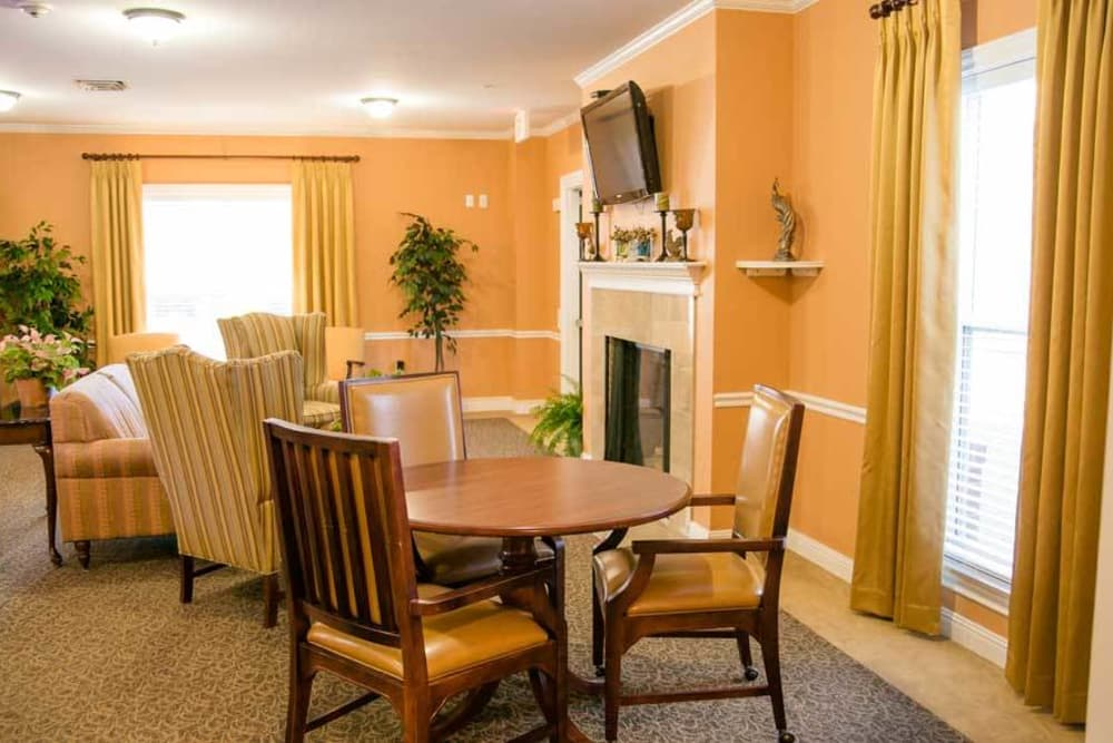 Room with fireplace and TV at Grace Manor Assisted Living in Nashville, Tennessee