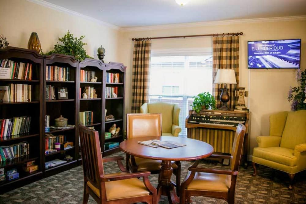 Reading room with comfy chairs at Grace Manor Assisted Living in Nashville, Tennessee