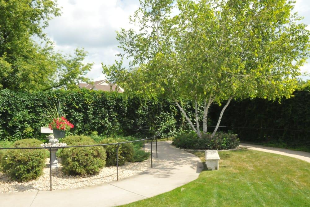 Serene walking path with well-kept flora at The Glenn Buffalo in Buffalo, Minnesota