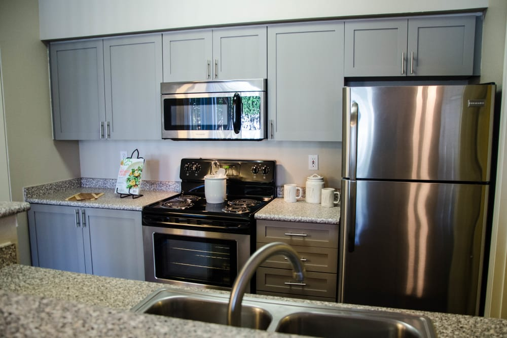 Custom Grey Cabinetry with stainless steel appliances