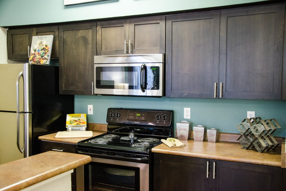 Renovated Brown Spacious Kitchen with Stainless steel appliances at Wildreed Apartments