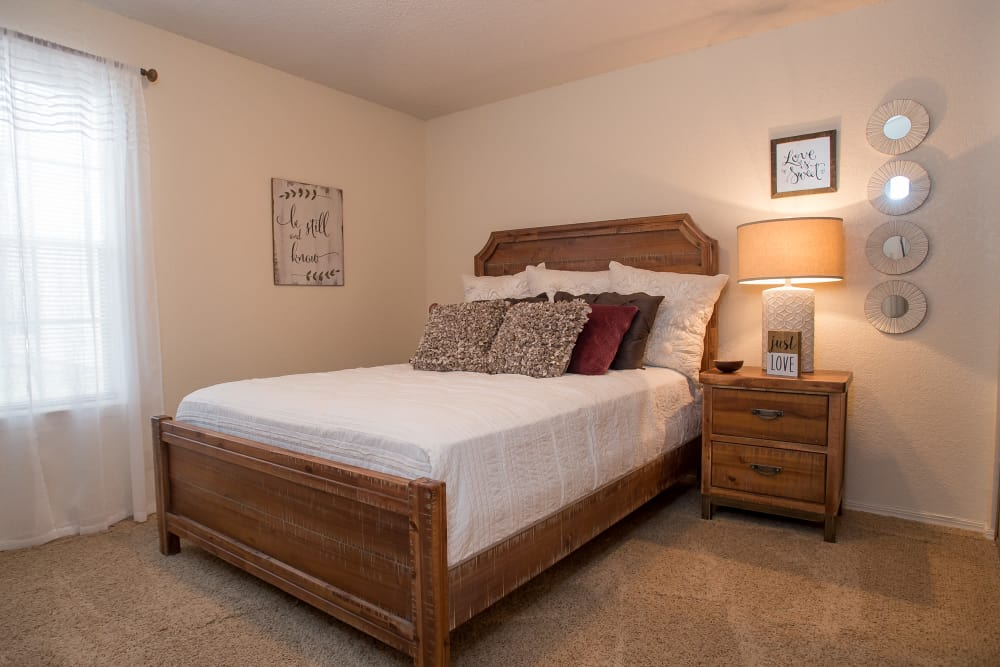 Well-lit bedroom at Tammaron Village Apartments in Oklahoma City, Oklahoma