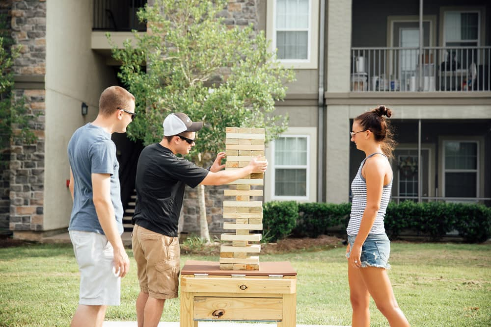 Three friends play games at Belmere Luxury Apartments in Houma, LA