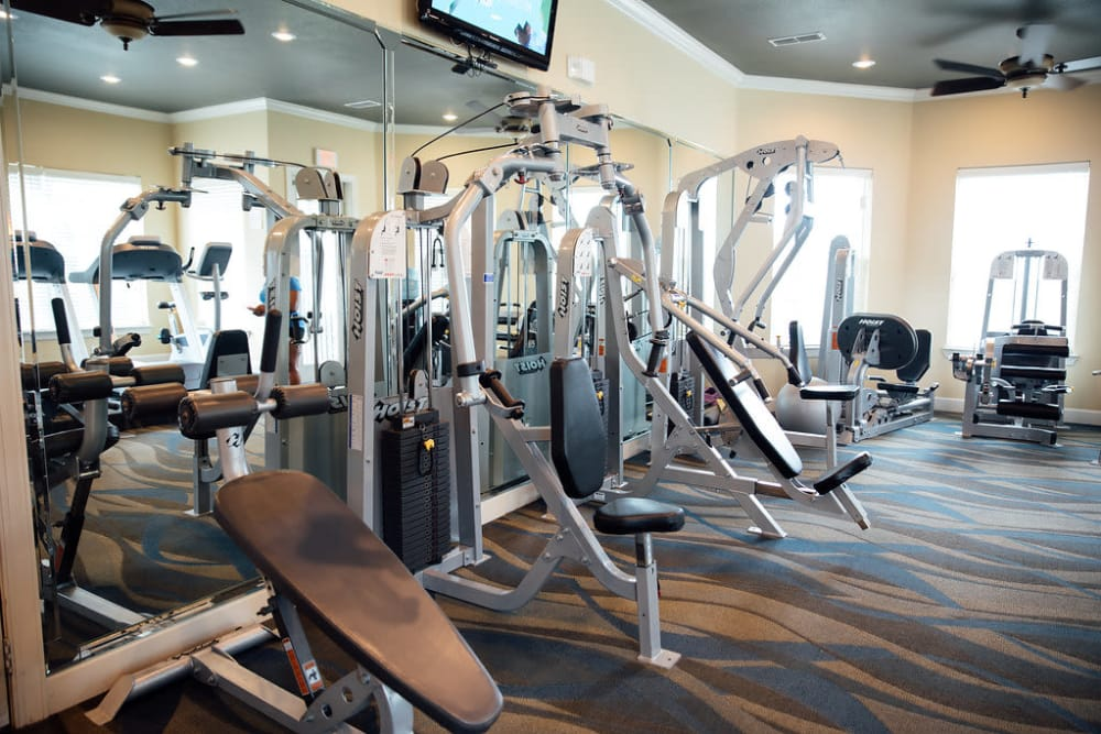 Various exercise equipment at Belmere Luxury Apartments in Houma, LA