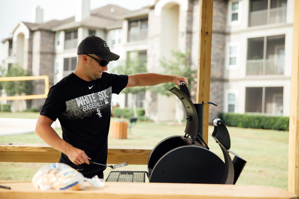 Someone grilling at Belmere Luxury Apartments in Houma, LA