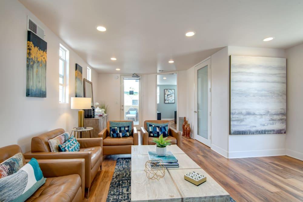 living rooms with hardwood floors at Villas at Carlsbad