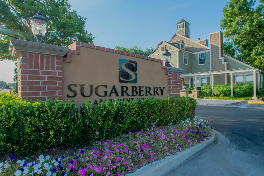 Our sign welcoming residents and their guests to our community at Sugarberry Apartments in Tulsa, Oklahoma
