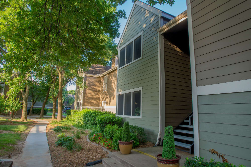 Resident buildings and well-maintained landscaping at Sugarberry Apartments in Tulsa, Oklahoma