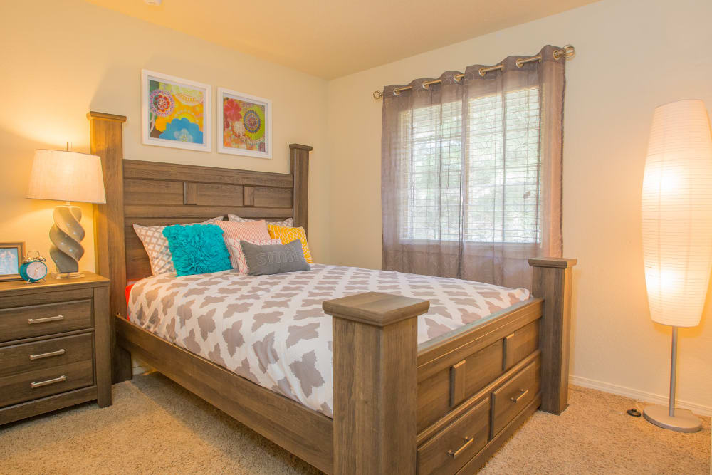 Well-lit bedroom with window treatments in model home at Chardonnay in Tulsa, Oklahoma