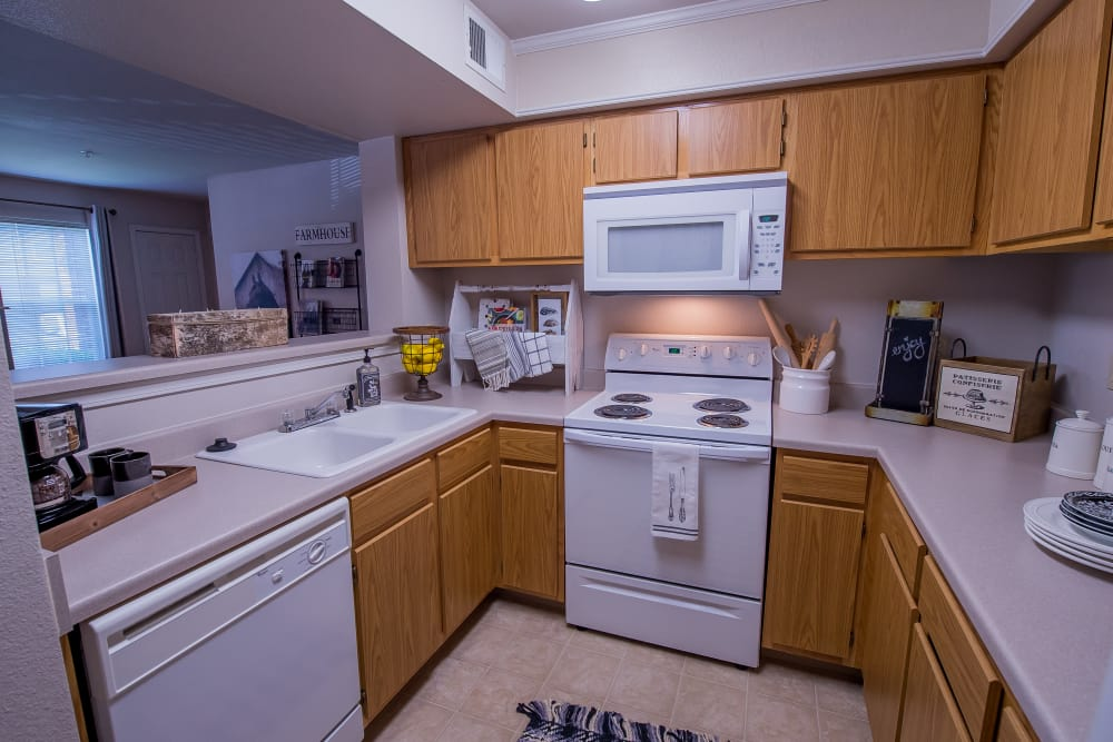 Kitchen with white appliances at The Remington Apartments in Wichita, Kansas