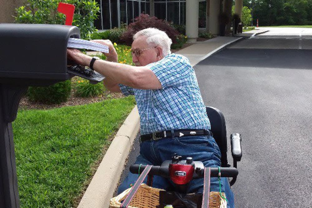 A resident checking the mail at The Villages at Historic Silvercrest in New Albany, Indiana