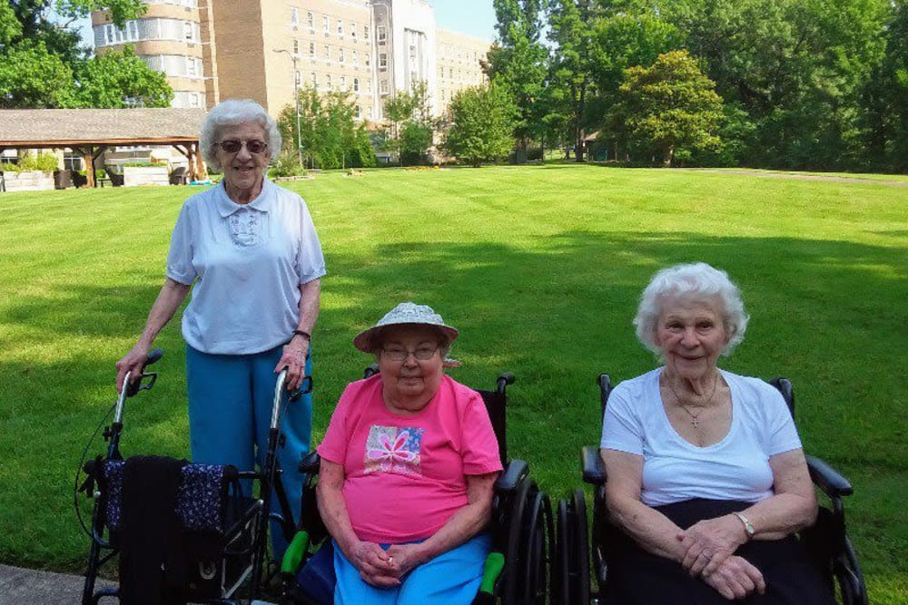 A group of happy residents enjoying the sunshine at The Villages at Historic Silvercrest in New Albany, Indiana