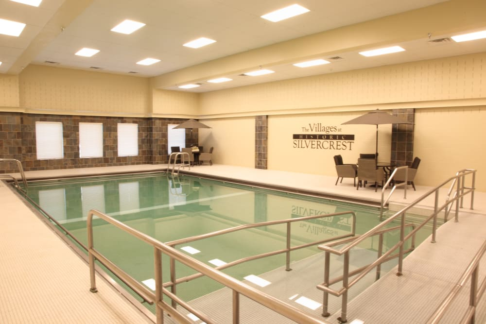 Indoor community pool with a ramp to get in at The Villages at Historic Silvercrest in New Albany, Indiana