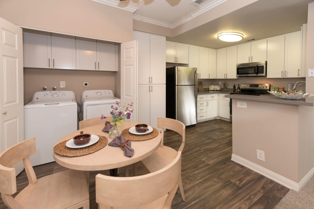 Dining room with a washer and dryer at Paloma Summit Condominium Rentals in Foothill Ranch, California