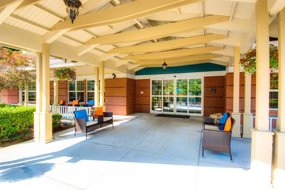 Covered outside sitting area  at Bridgeport Place Assisted Living in University Place, Washington