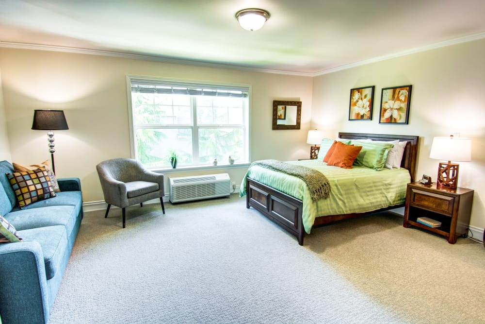 Spacious bedroom at Bridgeport Place Assisted Living in University Place, Washington