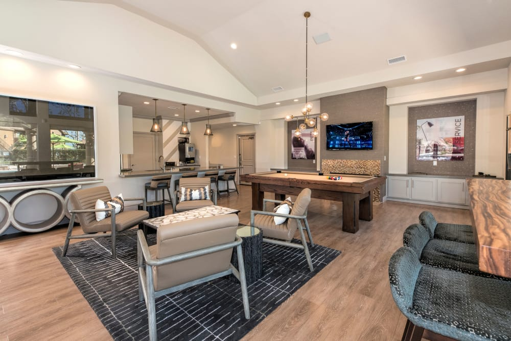 Clubhouse with a billiards table and comfortable seating at Paloma Summit Condominium Rentals in Foothill Ranch, California