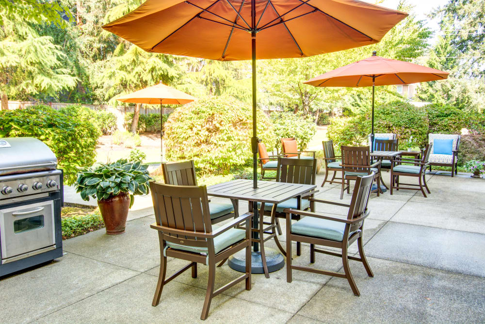 Barbecue area with covered seating  at Bridgeport Place Assisted Living in University Place, Washington