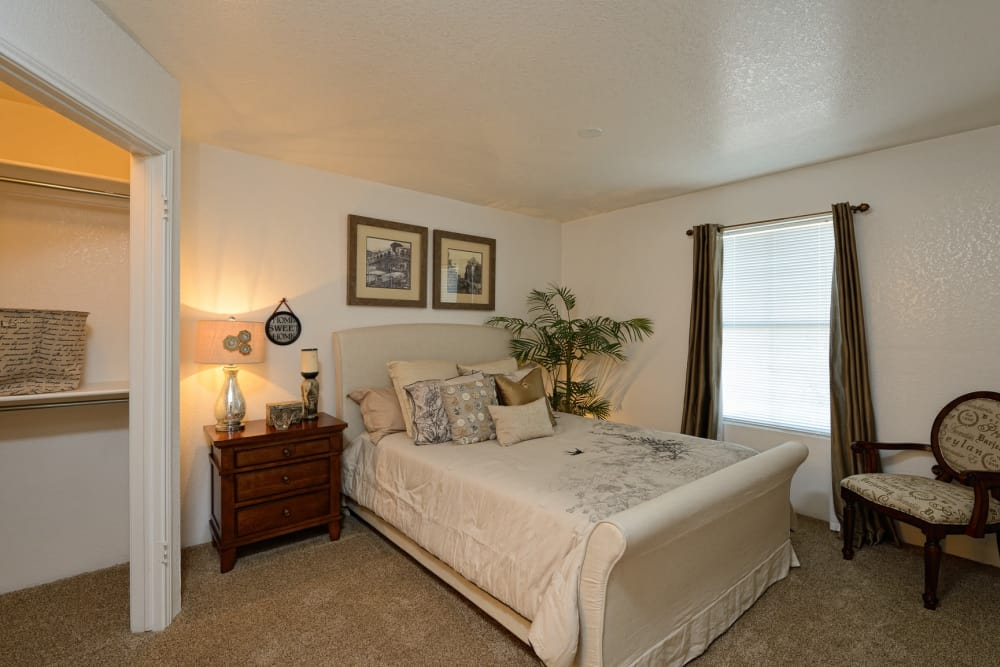 Cozy bedroom at Acacia Park Apartments in El Paso, Texas
