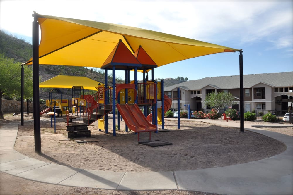 Outdoor playground at Acacia Park Apartments in El Paso, Texas