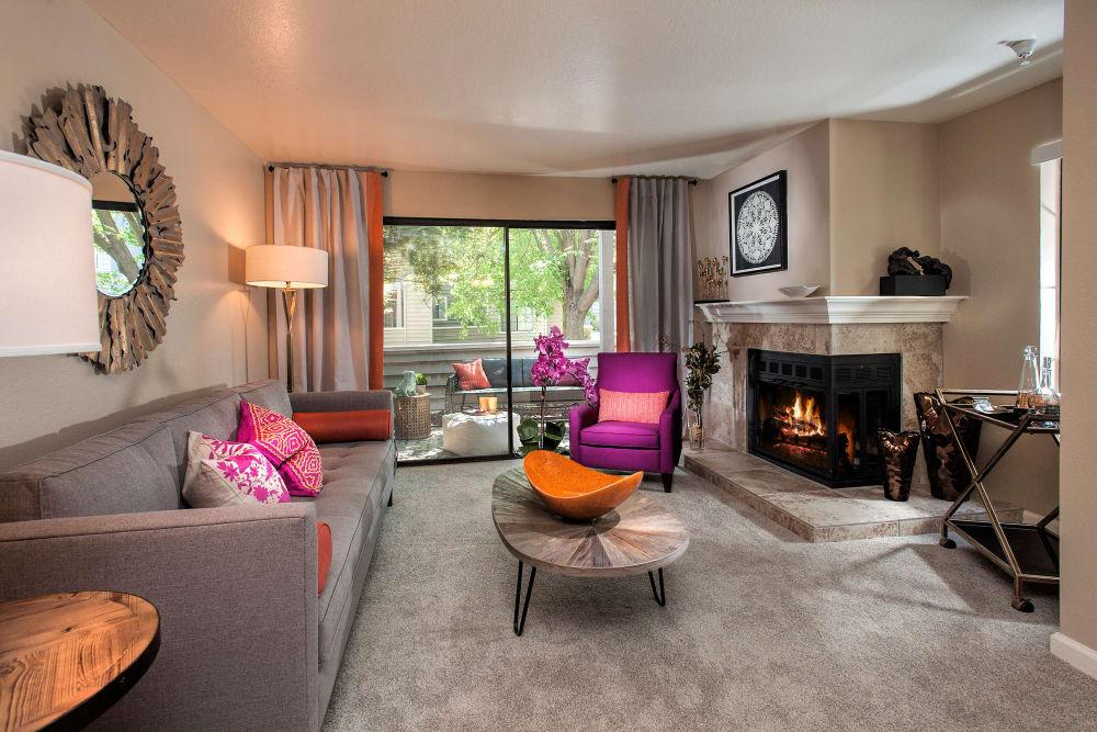 Living room with large windows for natural lighting at Hidden Lake Condominium Rentals in Sacramento, California
