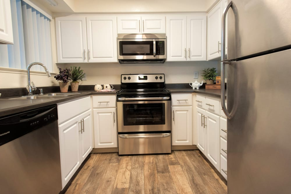 Kitchen with wood-style flooring at Hidden Lake Condominium Rentals in Sacramento, California