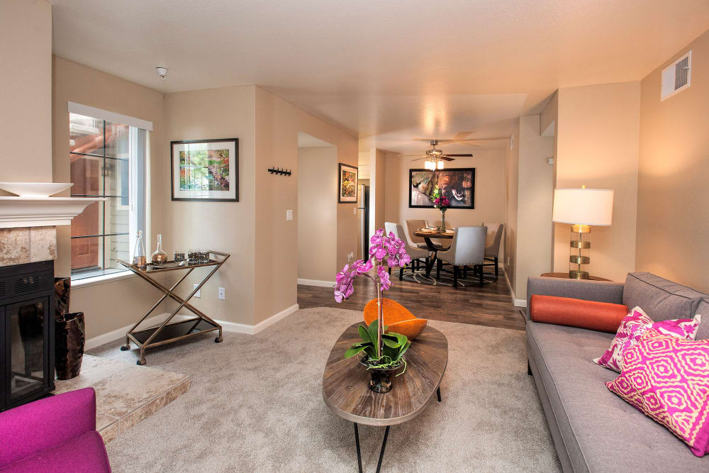 Spacious living room with plush carpeting in a model home at Hidden Lake Condominium Rentals in Sacramento, California