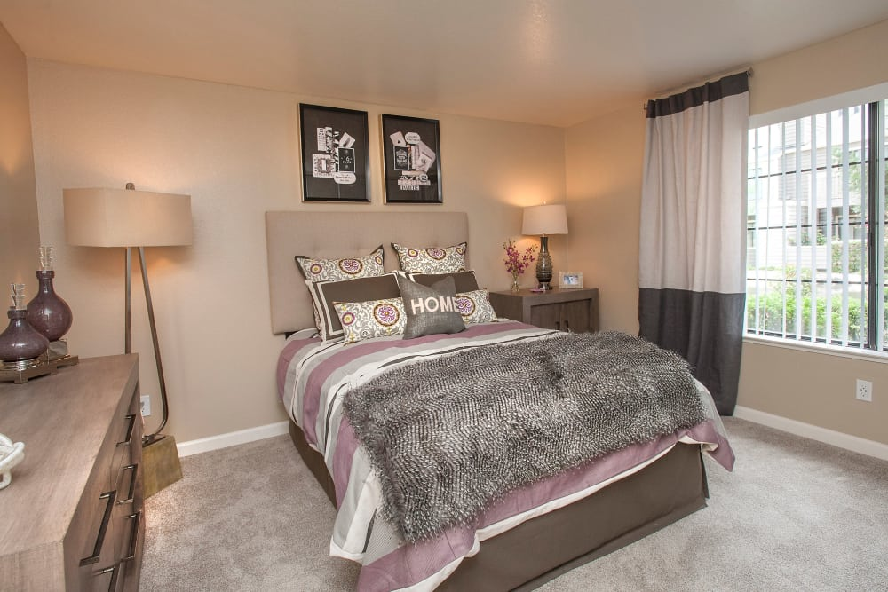 Model bedroom with unique light fixtures at Hidden Lake Condominium Rentals in Sacramento, California